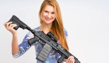 Image from social media of Butina holding a Russian-made Vepr. .308