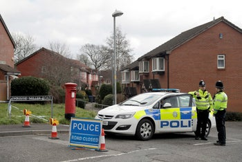 Police cordon off the road of the residence of former Russian double agent Sergei Skripal in Salisbury, England, March 13, 2018.
