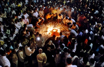 Activists with the Shiv Sena Hindu party light candles to pay tributes for the victims of the Mumbai terror attack in Mumbai, India, carried out by Lashkar-e-Taiba, an Islamic terrorist group based in Pakistan. November 28, 2008