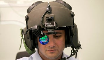FILE PHOTO: A man demonstrates wearing Elbit System's advanced helmet mounted system.