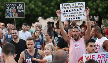 Protesters in Tel Aviv demonstrating against gay discrimination in surrogacy law, July 19, 2018.