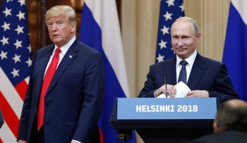 President Donald Trump and Russian President Vladimir Putin arrive for a press conference after their meeting at the Presidential Palace in Helsinki, July 16, 2018.