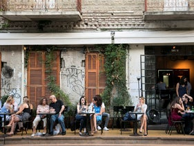 People sitting at a Tel Aviv cafe.