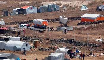 Refugees coming to border between Syria and Israel by a camp for displaced Syrians near the Syrian village of Burayqah in the southern province of Quneitra, July 17, 2018.