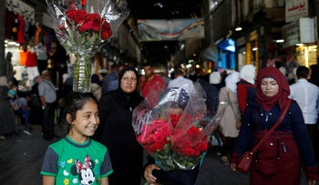 Syrian girls sell flowers at the Hamadiyah Market in the Old City of Damascus, July 19, 2018.