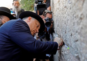 Hungarian Prime Minister Viktor Orban placing a note in the Western Wall in Jerusalem, July 20, 2018.