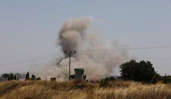 Smoke can be seen following an explosion near the Quneitra border crossing between Israel and Syria, as seen from the Israeli-occupied Golan Heights July 21, 2018