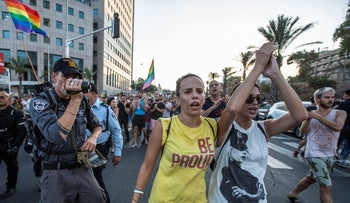 Protesters against the surrogacy law march in Tel Aviv on July 19, 2018.