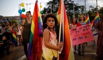 Protesters take part in a LGBT community members protest against discriminatory surrogate bill in Rabin Square in Tel Aviv, Israel, July 22, 2018.