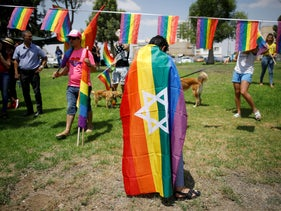 Demonstrators take part in a LGBT community members protest against a discriminatory surrogate bill in Beersheba, Israel July 22, 2018.