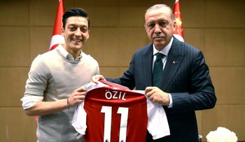 Turkey's President Recep Tayyip Erdogan poses for a photo with Mesut Ozil in London, May 13, 2018.