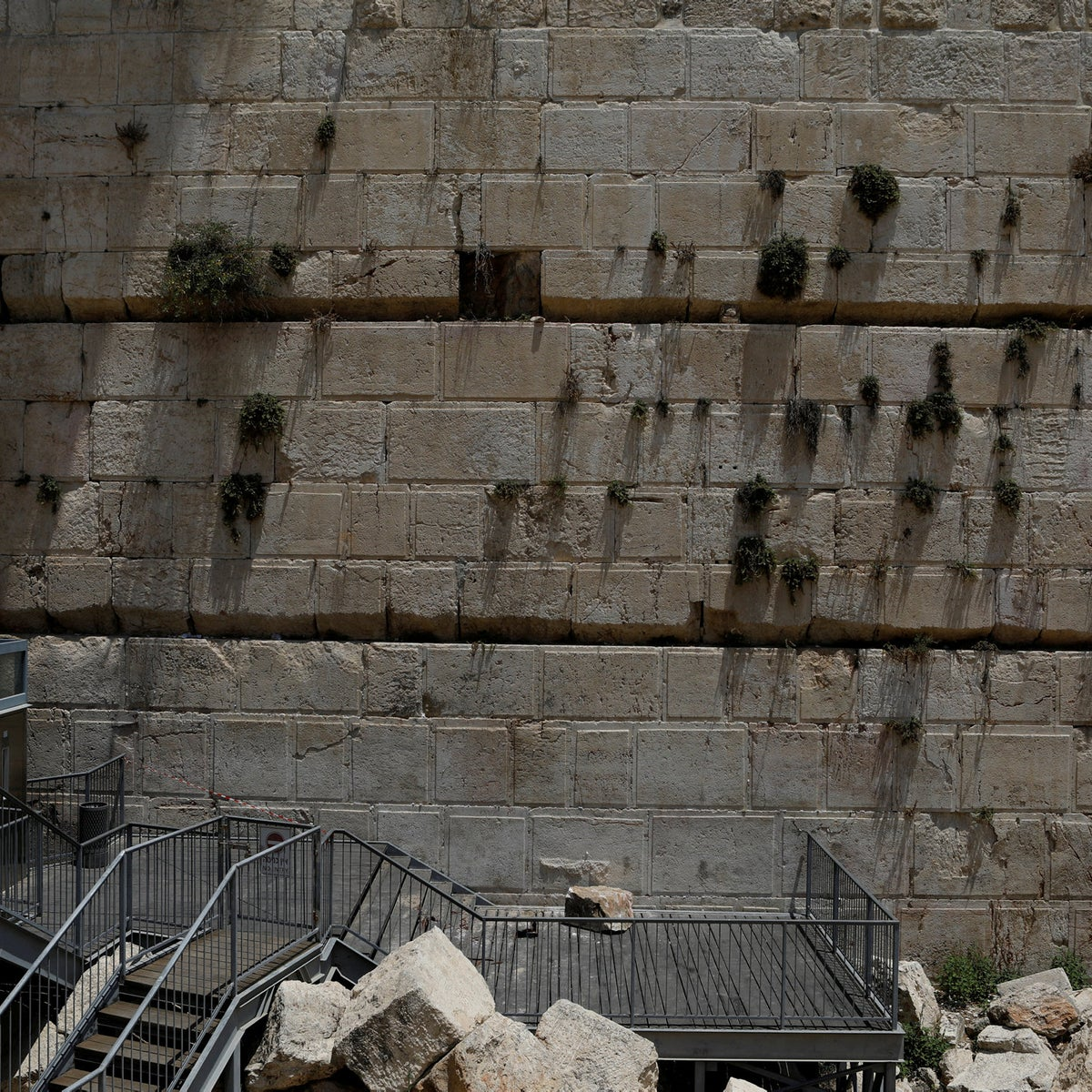 The stone that fell off the Western Wall can be seen near the wall in Jerusalem's Old City,  July 23, 2018.