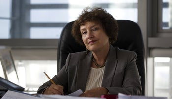 Bank of Israel Governor Karnit Flug sits in her office in Jerusalem during an interview with Reuters in October 2015
