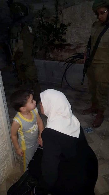 Lama Khater saying goodbye to her young son before being taken away by Israeli soldiers in Hebron, July 24, 2018.