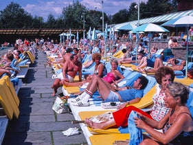 Guests sit by the pool at Grossinger's Catskill Resort Hotel, in 1977.