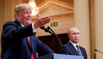 U.S. President Donald Trump gestures during a joint news conference with Russia's President Vladimir Putin after their meeting in Helsinki, Finland, July 16, 2018