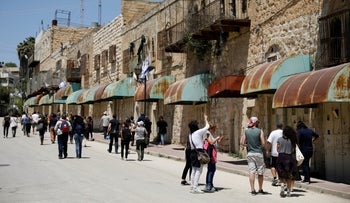 Visitors on a tour with the left-wing NGO Breaking the Silence in the West Bank city of Hebron, April 2017.