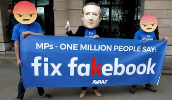FILE PHOTO: Protesters demonstrate against Facebook outside Portcullis House in Westminster, London, April 26, 2018.