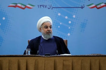 President Hassan Rouhani attends a meeting with foreign ministry officials in Tehran, July 22, 2018.