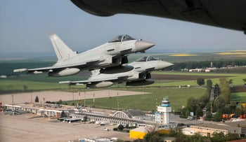 Royal Air Force Eurofighter Typhoon fighter jets fly above the Mihail Kogalniceanu airport, eastern Romania, April 27, 2018.