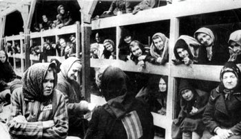 Women are pictured in their barrack after the liberation of Auschwitz, January 1945.