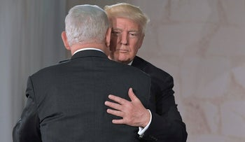 U.S. President Donald Trump and Israeli Prime Minister Benjamin Netanyahu hug after speaking at the Israel Museum in Jerusalem, May 23, 2017