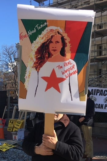 Sign calling Ahed Tamimi 'the REAL Wonder Woman' during a protest outside the AIPAC Policy Conference in Washington D.C. this year