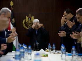 Palestinian President Mahmoud Abbas prays during the Fatah Central Committee meeting at the Palestinian Authority headquarters, in the West Bank city of Ramallah, May 29, 2018.
