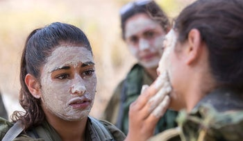 Israeli female soldiers from the mixed-gender Bardalas battalion take part in training at a military camp in northern Israel.
