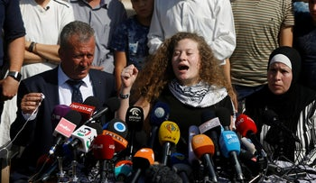 Ahed Tamimi speaking during a press conference outside the West Bank village of Nabi Saleh on July 29, 2018.