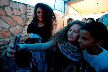 Ahed Tamimi taking a selfie with friends in the West Bank village of Nabi Saleh upon her release from prison after an eight-month sentence.
