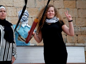Ahed Tamimi posing for a picture with her mother Nariman after a press conference in the West Bank village of Nabi Saleh on July 29, 2018.