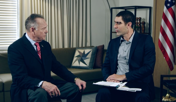 "Roy Moore, left, with Sacha Baron Cohen in ""Who is America?"""