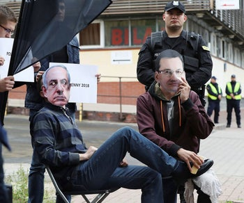 Members of a far-right group wear masks of Poland's PM Mateusz Morawiecki and Israeli PM Benjamin Netanyahu to criticize Morawiecki's 'backtracking' on parts of a Holocaust speech law. Warsaw, Poland. July 2, 2018