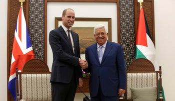 Britain's Prince William shakes hands with Palestinian President Mahmoud Abbas in Ramallah, June 27, 2018.
