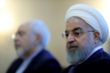 Iranian President Hassan Rohani, right, attending a meeting with a group of foreign ministry officials in Tehran, July 22, 2018. Foreign Minister Mohammad Javad Zarif is to his left.
