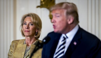 Betsy DeVos, U.S. secretary of education, listens as U.S. President Donald Trump speaks during the National Teacher of the Year reception at the White House, Washington, May 2, 2018.
