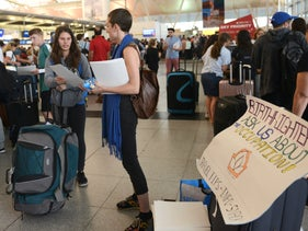 IfNotNow activists talk with young American Jews embarking to Israel for Birthright at JFK airport in New York City. July 30th 2018.
