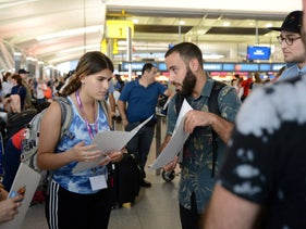 IfNotNow activists talking with a Birthright participant at JFK airport, New York City, July 30, 2018.