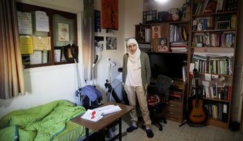 Arab-Israeli poet Dareen Tatour, 35, poses for a picture during an interview at her house in Reineh, northern Israel September 26, 2017.