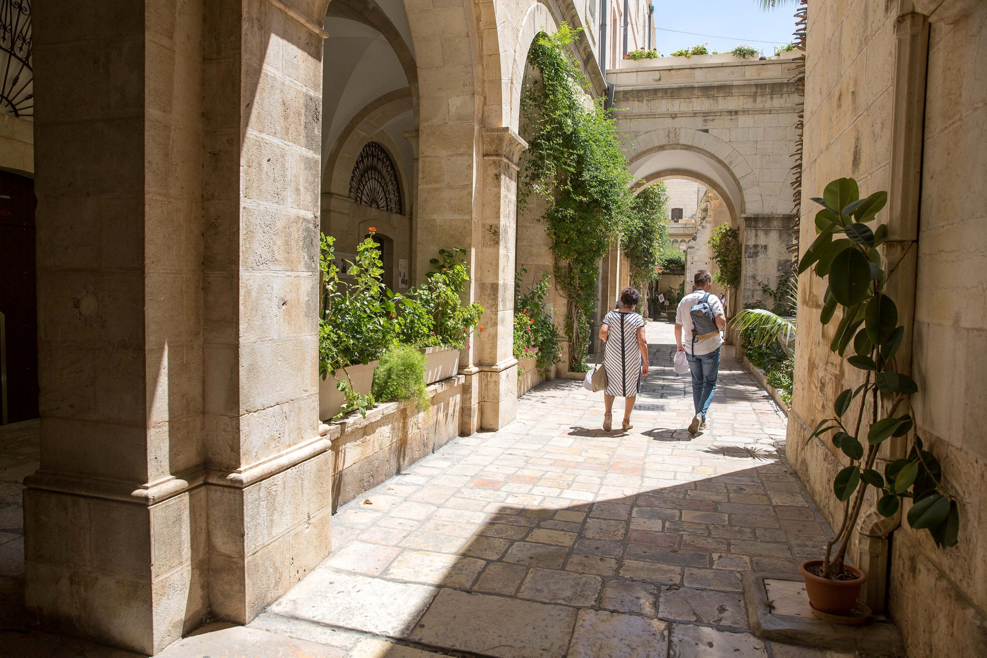 Visitors are walking inside the Monastery of the Flagellation.