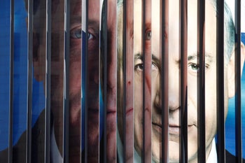 The faces of Benjamin Netanyahu and Isaac Herzog on an election sign in 2015