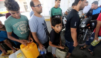 Palestinians wait to fill containers with fuel after Israel stopped the transfer of fuel and cooking gas into Gaza, Khan Younis, Gaza Strip, July 17, 2018.