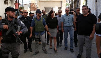 Culture Minister Miri Regev, center, walking through Silwan for the dedication of a Jewish heritage center in the E. J'lem neigbhorhood, August 1, 2018.
