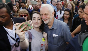 U.K. Labour Party leader Jeremy Corbyn posing for a selfie with an attendee at the Labour Live festival in London, June 16, 2018.