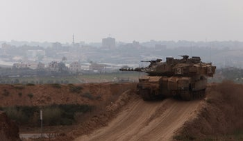 An Israeli tank is seen stationed at the border with Gaza, August 3, 2018.