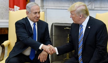 Prime Minister Benjamin Netanyahu hakes hands with U.S. President Donald Trump during a meeting in the Oval Office of the White House, Washington, March 5, 2018.