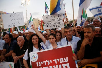 Tens of thousands of people attending the rally against the nation-state law in Tel Aviv's Rabin Square.