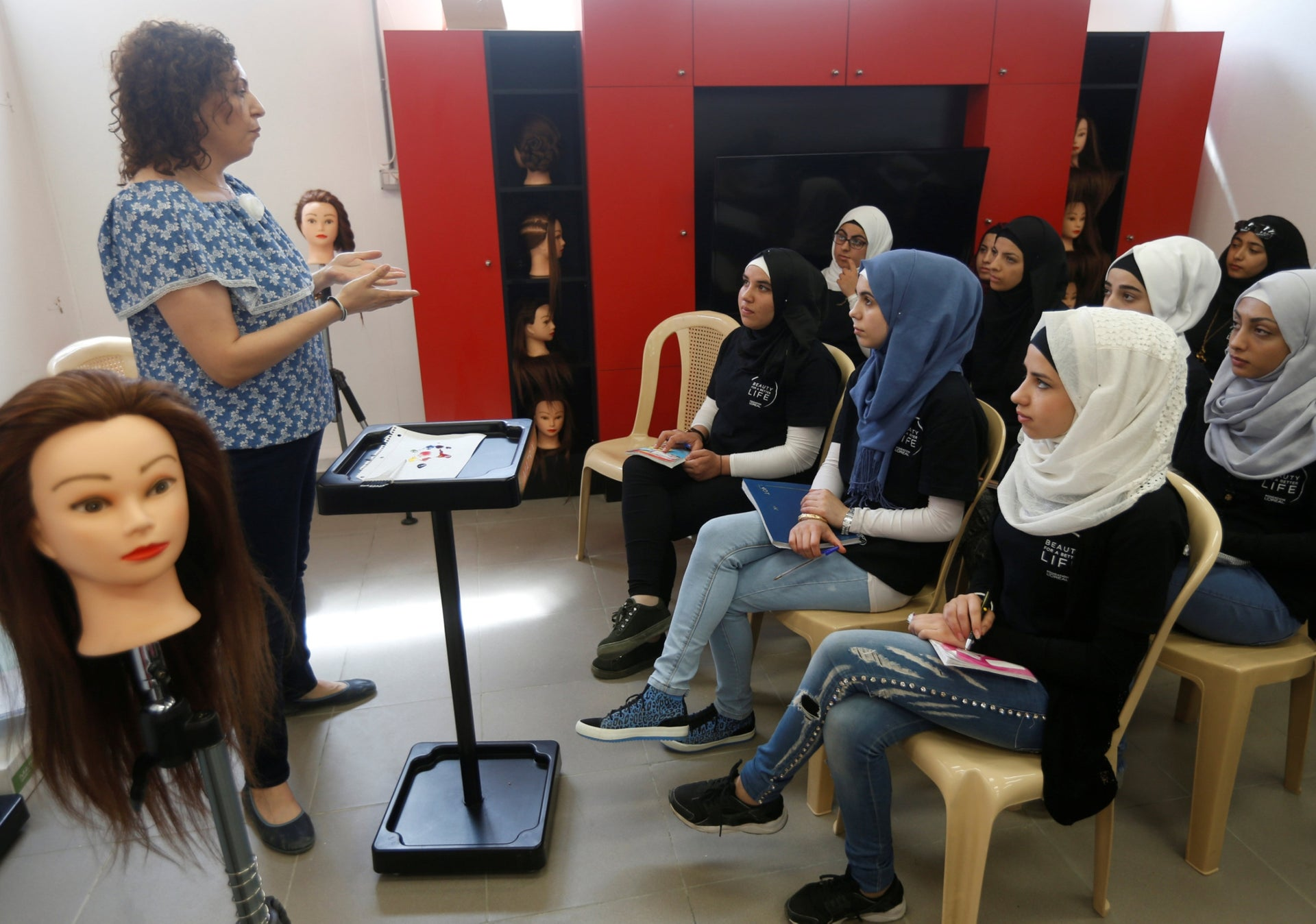 Refugees on the Syrian-Lebanese border studying with the L'Oreal Foundation's Beauty for a Better Life program