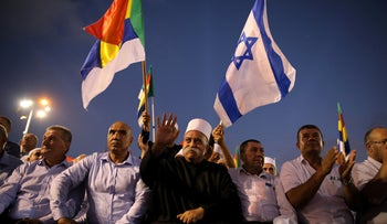 Leaders from the Druze minority together with others take part in a rally to protest against Jewish nation-state law in Rabin square in Tel Aviv, Israel August 4, 2018.
